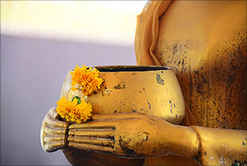 Buddha with bowl and flowers