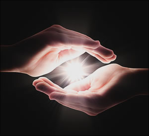 Hands holding light